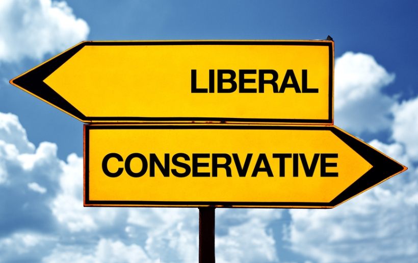 Liberal or conservative, opposite signs. Two blank opposite signs against blue sky background.